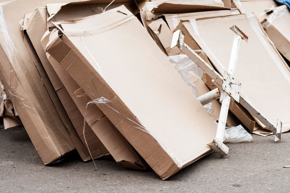 Rows of cardboard boxes that have been damaged