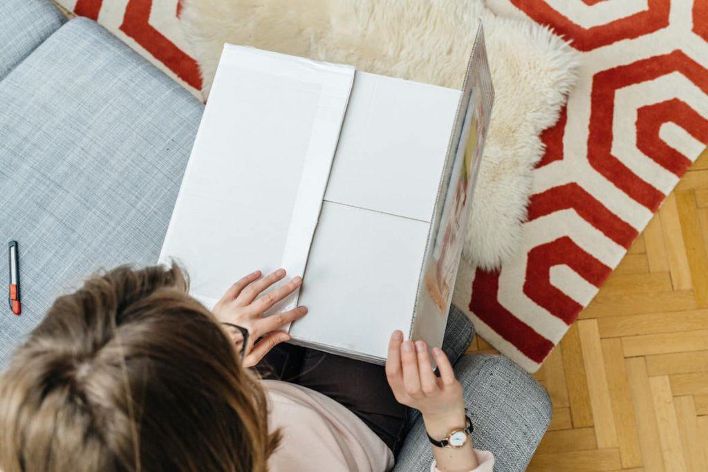 woman opening a cardboard box